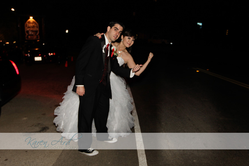 bride and groom hitchhiking.jpg