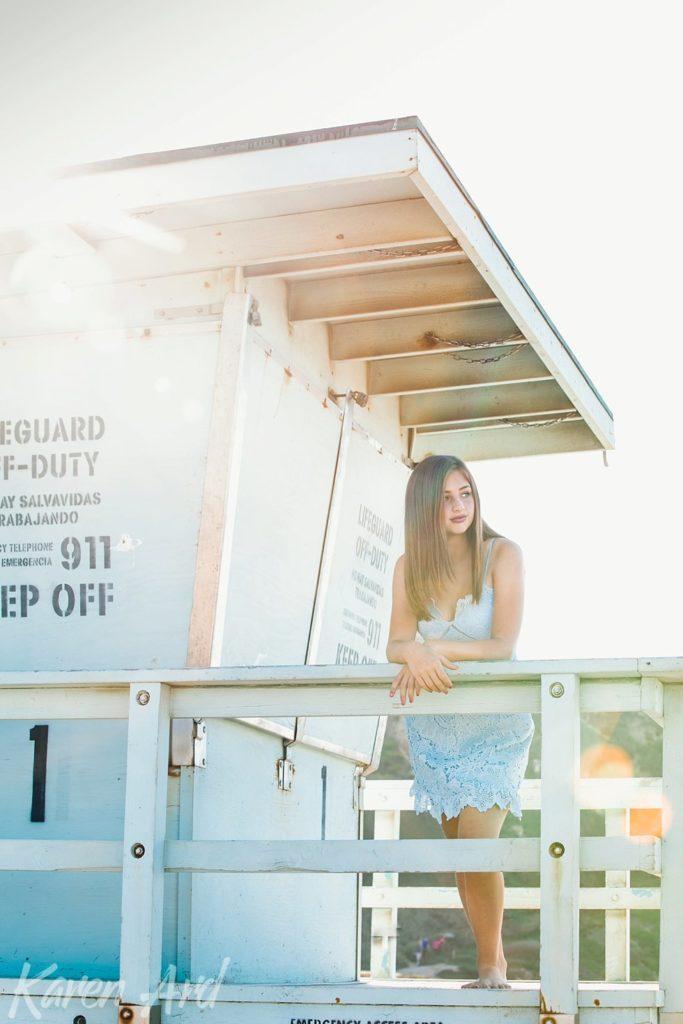 girl posing on lifeguard station