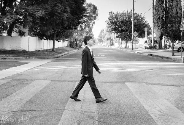 boy walking across the street like abbey road